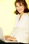 Happy_woman_with_laptop_looking_up